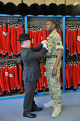 © licensed to London News Pictures. Windsor, UK  21/04/2011. Master Tailor measured the guards for their ceremonial dress unifirms whic they will wear on the wedding day. The Irish Guards at Victoria Barracks, Windsor prepare for the Royal Wedding in a weeks time on 29th April 2011. The Commanding Officer Chris Ghika gave a parade of inspection with the Irish Guards Master Tailor Lance Sergeant Matthew Else. Please see special instructions for usage rates. Photo credit should read Theodore Wood/LNP