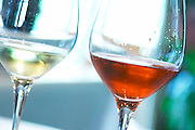 A glass of rose champagne Dizy 1er Premier Cru Terres Rouges 2002 (100% pinot Meunier - very unusual) very darkly coloured in a tasting glass and a glass of white blanc de blanc Dizy 1er Premier Cru Corne Bautray 2000 (100% chardonnay), Champagne Jacquesson in Dizy, Vallee de la Marne, Champagne, Marne, Ardennes, France, low light grainy grain