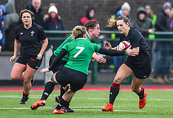 Wales women's Kerin Lake is tackled by Ireland women's Claire Molloy<br /> <br /> Photographer Craig Thomas/Replay Images<br /> <br /> International Friendly - Wales women v Ireland women - Sunday 21th January 2018 - CCB Centre for Sporting Excellence - Ystrad Mynach<br /> <br /> World Copyright © Replay Images . All rights reserved. info@replayimages.co.uk - http://replayimages.co.uk