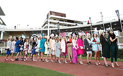 Female racegoers takes part in the Miss Cheltenham finalists line up alongside Miss England Stephanie Hill (centre left) during Ladies Day of the 2018 Cheltenham Festival at Cheltenham Racecourse.