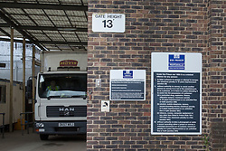 """© licensed to London News Pictures. London, UK 28/06/2012. HM Pentonville Prison doors opening as a truck leaves the prison today. John Massey escaped from Pentonville prison in Islington at around 6.30pm on Wednesday. He was sentenced to life imprisonment for murdering a man in a pub in Hackney in 1975. Scotland Yard said he is considered """"potentially dangerous"""" and should not be approached.. Photo credit: Tolga Akmen/LNP"""