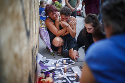 Friends of 18-year-old Danforth shooting victim Reese Fallon, Desirae Shapiro 19, right, and her mother Gina Shapiro, left, react after visiting a makeshift memorial remembering the victims of a shooting on Sunday evening on Danforth, Ave. in Toronto, ON, Canada, on Monday, July 23, 2018. Photo by Mark Blinch/CP/ABACAPRESS.COM