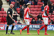 Charlton Athletic attacker Lyle Taylor (9) and ref laughing after pown goal during the EFL Sky Bet League 1 match between Charlton Athletic and Rochdale at The Valley, London, England on 4 May 2019.