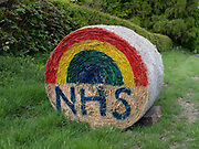 A haybale decorated with a rainbow in support of NHS workers during the Coronavirus pandemic on 8th May 2020 in North Yorkshire, United Kingdom.