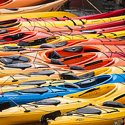 A fleet of rental Kayaks in Rockport, MA are idle on a storm June afternoon.