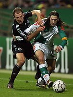 Photo: Paul Thomas.<br /> Werder Bremen v Chelsea. UEFA Champions League, Group A. 22/11/2006.<br /> <br /> Arjen Robben (L) of Chelsea and Torsten Frings.