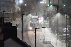 © Licensed to London News Pictures. 31/01/2019. London, UK. A bus drives on the snow covered streets of Wembley. Photo credit: Ray Tang/LNP