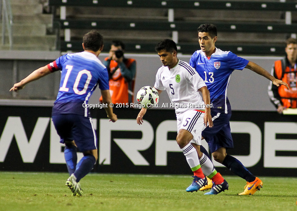United States' Jorge Villafana #13 and Mexico's Jorge Caballero #5 fight for a ball during a men's national team international friendly match, April 22, 2015, at StubHub Center in Carson, California. United States won 3-0. (Photo by Ringo Chiu/PHOTOFORMULA.com)