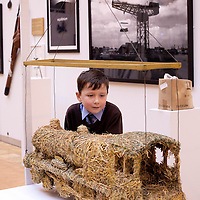 Picture shows: Matthew Sweeney of St Fillan's Primary, Renfrewshire...GEORGE WYLLIE RETROSPECTIVE: .IN PURSUIT OF THE QUESTION MARK..ARTIST'S LIFE LESS ORDINARY ON SHOW..THE life and work of George Wyllie, MBE, who died in May this year at the age of 90, is the subject of In Pursuit of the Question Mark, which is being curated by his elder daughter, Louise Wyllie...The exhibition is the most comprehensive survey of the internationally renowned Glasgow-born artist's work ever mounted and consists of almost 1000 objects. These range from his earliest drawings made for family when he was serving on HMS Argonaut in The Pacific during the Second World War, to his Cosmic Bunnet, made for his last ever solo exhibition in 2005...Wyllie described himself as a 'scul?tor' because, he said, the question mark should always be at the centre. His ambition as an artist, writer and philosopher was to bring art to the attention of the wider world with an engaging, and often humorous take on his chosen subjects...Some of the artist's earliest sculptural work has also been tracked down. This includes a Bumper Dolphin, made from old car bumpers, dating to the 1960s, and a peacock made from washers and scrap metal...The exhibition also features material which shows the process which led Wyllie to create iconic ephemeral works such as the Straw Locomotive and the Paper Boat...The Whysman Festival received funding from First in a Lifetime/Year of Creative Scotland 2012 to mount this exhibition and project-manage two community based projects; The Big Little Paper Boat Education Initiative which takes in over 90 Clydeside schools and the Big Clyde Question Project involving community groups in Inverclyde...GEORGE WYLLIE RETROSPECTIVE: IN PURSUIT OF THE QUESTION MARK.The Mitchell, North Street, Glasgow, G3 7DN.www.whysman.co.uk.3 November, 2012 - 2 February, 2013.Open Monday-Saturday, 10am-5pm