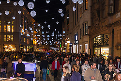 London, November 29th 2014. Tens of thousands of shoppers flood central London as  Black Friday discounts and most people's pay days kick off the Christmas shopping season in earnest. PICTURED: Thousands of shoppers continue their quest for Christmas bargains long after sunset.