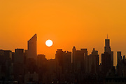 Skyline of Midtown Manhattan featuring the Citicorp Center, as seen at sunset from Queens, New York City.