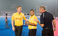 BHUBANESWAR  (INDIA)  - HERO Champions Trophy Hockey men. Day 1.  Germany vs India.  The umpires Coen van Bunge and Fernando Gomez with technical officer Rogier Warris (r) .PHOTO  KOEN SUYK