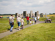 Large numbers of tourists visiting the World Heritage neolithic site of  standing stones at Stonehenge, Amesbury, Wiltshire, England, UK