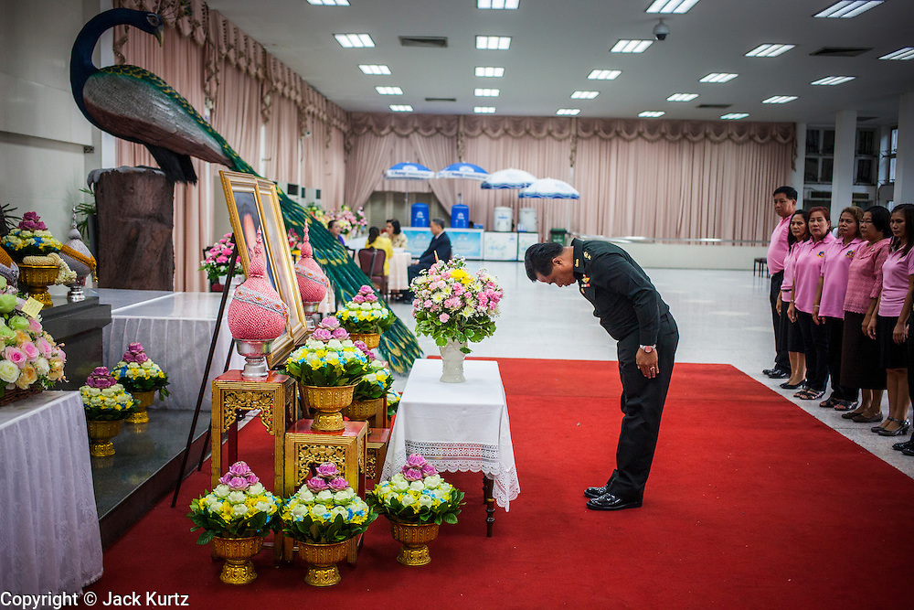 26 NOVEMBER 2012 - BANGKOK, THAILAND:   A military officer bows after making an offering of a gift for the hospitalized King of Thailand at Siriraj Hospital in Bangkok. Siriraj was the first hospital in Thailand and was founded by King Chulalongkorn in 1888. It is named after the king's 18-month old son, Prince Siriraj Kakuttaphan, who had died from dysentery a year before the opening of the hospital. It's reported to one of the best hospitals in Thailand and has been home to Bhumibol Adulyadej, the King of Thailand, since 2009, when he was hospitalized to treat several ailments. Since his hospitalization tens of thousands of people have come to pay respects and offer get well wishes. The King's 85th birthday is on Dec 5 and crowds at the hospital are growing as his birthday approaches. The King is much revered throughout Thailand and is seen as unifying force in the politically fractured country.      PHOTO BY JACK KURTZ