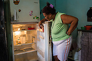 2016/05/26 - Caracas, Venezuela: Loida Teheran, 53, looks inside her almost empty fridge in 24 de Marzo section of the Petare slum. She only eats one meal per day in order to feed the four grandchildren that live with her.(Eduardo Leal)