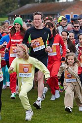 © Licensed to London News Pictures.  23/03/2014. OXFORD, UK. Prime minister DAVID CAMERON (centre left) and wife SAMANTHA CAMERON (centre right) and family at the start of the Oxford Sport Relief Mile. Photo credit: Cliff Hide/LNP