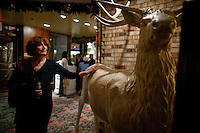 Kay LeRoy, widow of Warner LeRoy, the former owner of Tavern on the Green, gives a tour of what is to be auctioned as the restaurant nears it's end. Pictured is a hand carved Elk, one of two. .(Photo by Robert Caplin)..