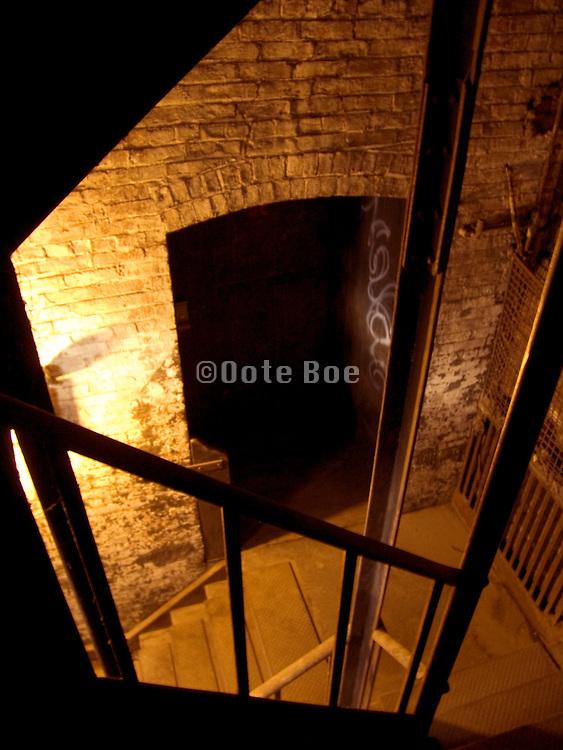 looking down in a dark dusty stairway