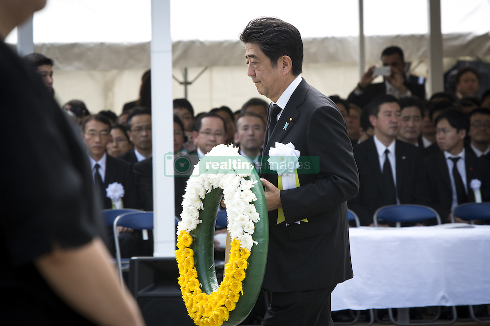 August 9, 2016 - Nagasaki, Nagasaki Prefecture, Japan - NAGASAKI, JAPAN - AUGUST 9 : Japanese Prime Minister Shinzo Abe walks with the wreath to offer for the atomic bomb victims in front of the Peace Statue in Nagasaki Peace Park, Nagasaki, southern Japan, Tuesday, August 9, 2016. Japan marked the 71st anniversary of the atomic bombing on Nagasaki. On August 9, 1945, during World War II, the United States dropped the second Atomic bomb on Nagasaki city, killing an estimated 40,000 people which ended World War II. (Credit Image: © Richard Atrero De Guzman/NurPhoto via ZUMA Press)