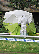 © licensed to London News Pictures. LONDON, UK.  22/06/11. a forensics officer at the scene. An investigation has begun after a man's body was found on Clapham Common.Two men have been arrested after the discovery early this morning (June 22). The death is being treated as unexplained. Mandatory Credit Stephen Simpson/LNP