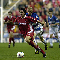 Copyright Sportsbeat. 0208 3926656<br />Picture: Henry Browne<br />Date: 18/04/2003<br />Reading v Nottingham Forest Nationwide First Division<br />Andy Reid of Forest is chased by Luke Chadwick of Reading