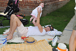 HUGO HEATHCOTE and his daughter LOLA at a cricket match to in aid of CARE - Corfu Animal Rescue Establishment held at Hawkley Cricket Club, Hawkley, Hampshire on 8th September 2012.
