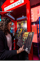 © Licensed to London News Pictures. 25/10/2021. LONDON, UK. Bowie fan, Farida Doss, with the Ziggy Stardust album at the opening of a David Bowie pop-up shop in Heddon Street in the West End.  Open 75 days before the late singer's 75th birthday, the pop-up is located close to where Bowie posed as Ziggy Stardust on the cover of his 1972 album The Rise and Fall of Ziggy Stardust and the Spider from Mars.  The store sells limited edition records and memorabilia curated by his estate and will be open until January 2022. A sister shop will open in New York and both form part of a year long celebration of David Bowie's 75th birthday.  Photo credit: Stephen Chung/LNP