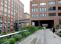 © licensed to London News Pictures.New York, USA  30/05/11. A view of the High Line. New York's newest public space, the High Line, a converted disused railway, is about to double in size. The former railway which has been converted into a free public park is due to open a new section in June. Once the extension opens the High Line will  will run from the stylish Meatpacking district through fashionable Chelsea all the way up to 30th Street. Photo credit should read Stephen Simpson/LNP