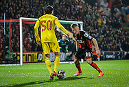 Lazar Markovic and Matt Ritchie during the Capital One Cup match between Bournemouth and Liverpool at the Goldsands Stadium, Bournemouth, England on 17 December 2014.