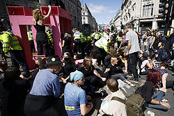 © Licensed to London News Pictures. 25/08/2021. London, UK. XR (Extinction Rebellion) protesters block Oxford Circus on a global day of action. XR are on day three of a planned two week protest in the captital calling for action on climate change. Photo credit: Peter Macdiarmid/LNP