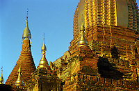 BURMA (MYANMAR), Mandalay Division, Bagan. 2006. The brilliant gold of Shwe Gu Gyi beckons from across the Bagan plain. This temple is one of a small number that have an active caretaker.