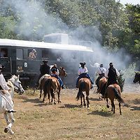 People in period dresses reenact a bandit attack on a train in the Skanzen open air folk museum in Szentendre, Hungary on Aug. 19, 2018. ATTILA VOLGYI
