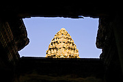 19 MARCH 2006 - SIEM REAP, SIEM REAP, CAMBODIA: The upper most level of the main Angkor Wat complex as seen through a window in a lower level of the complex near Siem Reap, Cambodia. Cambodian authorities estimate that more than one million tourists will visit Angkor Wat in 2006, making it the leading tourist attraction in Cambodia by a large margin.   Photo by Jack Kurtz
