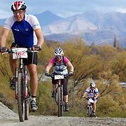 Angus Bradshaw (left), Victoria Robertson (centre) and Shane Muir (right) in during the New World Tour de Wakatipu bike race on Saturday. Six hundred and ninety people entered the bike race which featured an  exclusive course with breathtaking views from Millbrook Resort in Arrowtown to Chard Farm along the Kawarau River, via the trails and tracks of the Wakatipu basin with distances of 36 kilometres fun riding for recreational bikers and 45 kilometres for elite and sport racers. The event was part of the inaugural Queenstown Bike Festival, which took place from 16th-25th April. The event hopes to highlight Queenstown's growing profile as one of the three leading biking centres in the world. Queenstown, Central Otago, New Zealand. 23rd April 2011. Photo Tim Clayton..