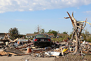 A car sits the driveway of a destroyed house in the neighborhood near the Plaza Towers elementary school in Moore, Oklahoma May 22, 2013. A massive tornado tore through a suburb of Oklahoma City, wiping out whole blocks and killing at least 24.   REUTERS/Rick Wilking (UNITED STATES)