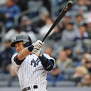 Derek Jeter, New York Yankees, hits a double during the New York Yankees V Baltimore Orioles home opening day at Yankee Stadium, The Bronx, New York. 7th April 2014. Photo Tim Clayton