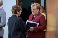 09 OCT 2019, BERLIN/GERMANY:<br /> Annegret Kramp-Karrenbauer (L), CDU, Bundesverteidigungsministerin, und Angela Merkel (R), CDU, Bundeskanzlerin, im Gespraech, vor Beginn der Kabinettsitzung, Bundeskanzöeramt<br /> IMAGE: 20191009-01-029<br /> KEYWORDS: Sitzung, Kabinett, Gespräch