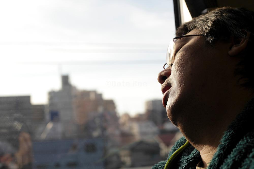 Japan Tokyo man during a commuting nap
