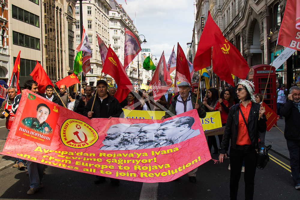 London, May 1st 2015. Hundreds of workers and Trade Unionists from across the UK are joined by Turks, Kurds and anti-capitalists as they march through London on May Day.