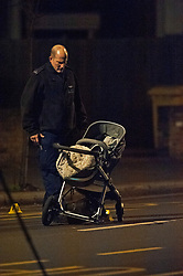 © Licensed to London News Pictures. 14/01/2019. Anerley, UK.Police officer next to a pushchair. A mother has been killed and a child is in hosptial fighting for life after being hit by a car crossing the road in Anerley near Penge.<br />   Photo credit: Grant Falvey/LNP