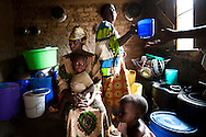 Mama Godfrey, wife of the late Mwita Machapelle with her family and mother inside her home in Nayagota, Tanzania, on Wednesday, July 28, 2010. Photographer: Trevor Snapp