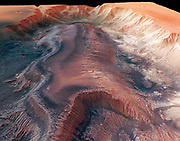 Mars Express High Resolution Stereo Camera image of Hebes Chasma.Hebes Chasma is an enclosed trough, almost 8000 m deep, in Valles Marineris, the Grand Canyon of Mars, showing Light Toned Deposits. This is an area where water is believed to have flowed. An analysis of data and images from Mars Express suggests that several Light Toned Deposits, some of the least understood structures on Mars, were formed when large amounts of groundwater burst on to the surface. Scientists propose that groundwater had a greater role in shaping the Martian surface than previously believed, and may have sheltered primitive life forms as the planet started drying up. Hebes Chasma is located at approximately 1° south and 282° east. Image data was obtained on 16 September 2005 with a ground resolution of approximately 15 m/pixel.