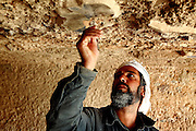 An Afghan archaeologist is working on the maintenance and restoration of the Buddhas of Bamiyanís archaeological site in collaboration with a Japanese team of experts who has been visiting the town for various years to find a long-term solution to its slow but unceasing disappearance. The Buddhas of Bamiyan were two 6th century monumental statues of standing Buddhas carved into the side of a cliff in the Bamiyan valley in the Hazarajat region of central Afghanistan, situated 230 km northwest of Kabul at an altitude of 2500 meters. The statues represented the classic blended style of Gandhara art. The main bodies were hewn directly from the sandstone cliffs, but details were modelled in mud mixed with straw, coated with stucco. Amid widespread international condemnation, the smaller statues (55 and 39 meters respectively) were intentionally dynamited and destroyed in 2001 by the Taliban because they believed them to be un-Islamic idols. Once a stopping point along the Silk Road between China and the Middle East, researchers think Bamiyan was the site of monasteries housing as many as 5,000 monks during its peak as a Buddhist centre in the 6th and 7th centuries. It is now a UNESCO Heritage Site since 2003. Archaeologists from various countries across the world have been engaged in preservation, general maintenance around the site and renovation. Professor Tarzi, a notable An Afghan-born archaeologist from France, and a teacher in Strasbourg University, has been searching for a legendary 300m Sleeping Buddha statue in various sites between the original standing ones, as documented in the old account of a renowned Chinese scholar, Xuanzang, visiting the area in the 7th century. Professor Tarzi worked on projects to restore the other Bamiyan Buddhas in the late 1970s and has spent most of his career researching the existence of the missing giant Buddha in the valley.