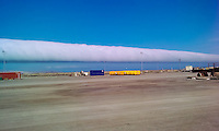 Azerbaijan, Baku. A roll cloud is a low, horizontal, tube-shaped, and relatively rare type of arcus cloud. At the SPS base just west of Baku.