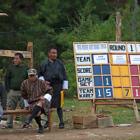 Asia, Bhutan, Bumthang. Archery scoreboard and spectators of Bhutan.