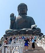 Tian Tan Buddah (Big Buddah) and tourists at Po Lin Monastery, Lantau Island, Hong Kong.