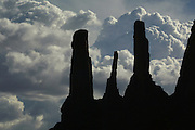 The rocks called the Three Sisters silhouetted in Monument Valley on the southern border of Utah with northern Arizona. The valley lies within the range of the Navajo Nation Reservation. The Navajo name for the valley is Tsé Bii' Ndzisgaii - Valley of the Rocks.