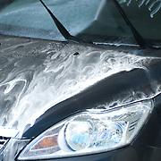 Close-up of blue car washing