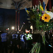 Hundreds of people gathered at a peaceful vigil for Sarah Everard on Clapham Common in South London on the 13th of March 2021, London, United Kingdom. Sarah Everard went missing on 3 March after setting off at 9pm from a friend's house to make her two-and-a-half-mile journey home and was days later found murdered. Flowers for Sarah Everard on the band stand. People had turned out to pay respect and love and mourn Sarah Everard as well as all the women and girls who on a daily basis are hurt by men. It was an event full of sadness and reflection and anger but peaceful. The vigil was not sanctioned by police because of Covid restrictions and the police decided to arrest a number of people in an attempt to break up the peaceful and highly emotional vigil. The event took place around the band stand on the common and speeches were held from the stand till police confiscated the sound equipment. The police have since been highly criticized for their handling of the event.