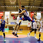 Anadolu Efes's Emircan Kosut (2ndL) and Dogus Balbay (C) during their Turkish Basketball League match Istanbul BSB between Anadolu Efes at Cebeci Arena in Istanbul Turkey on Monday 09 March 2015. Photo by Aykut AKICI/TURKPIX